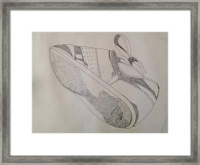 One Tennis Shoe Framed Print