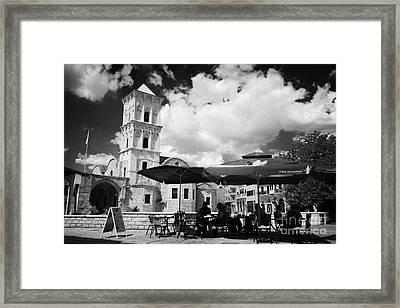onstreet cafes at St Lazarus Church with belfry larnaca republic of cyprus europe Framed Print by Joe Fox