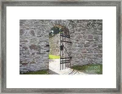 Open Gate Door In A Stone Wall Framed Print by Jaak Nilson