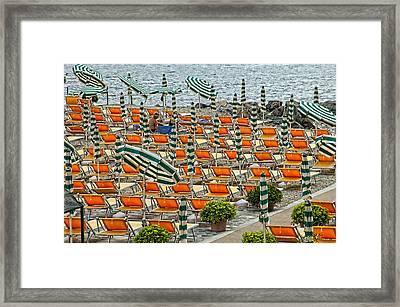 Orange Beach Chairs  Framed Print by Mauro Celotti