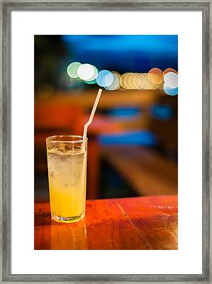 Orange Juice On Table Wilth Color Of Light Framed Print by Kittipan Boonsopit