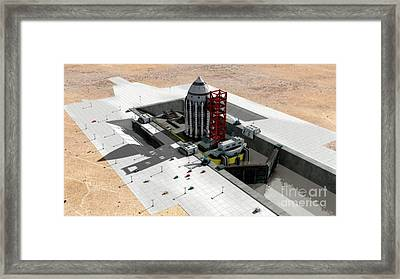 Orion-drive Spacecraft On A Remote Framed Print by Rhys Taylor