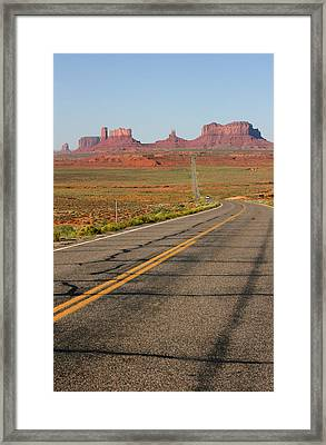 ouest USA route monument valley road Framed Print by Audrey Campion