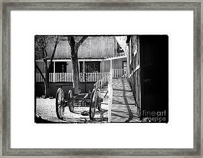 Outside The Saloon Framed Print by John Rizzuto
