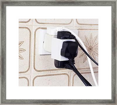 Overloaded Plug Socket Framed Print