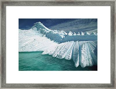 Overturned Iceberg With Eroded Edges Framed Print by Colin Monteath