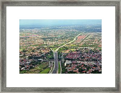 Overview Of Jakarta. Framed Print by TeeJe