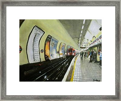 Oxford Circus Station Framed Print by Paul Mitchell