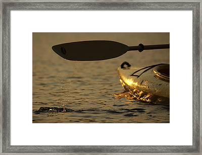 Paddling A Kayak Over Walden Pond Framed Print