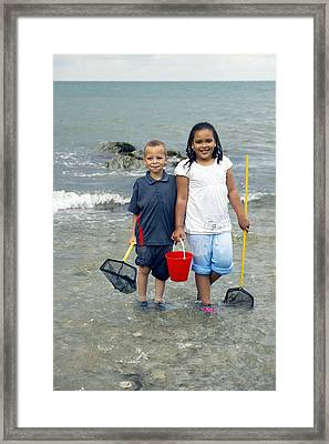 Paddling In The Sea Framed Print