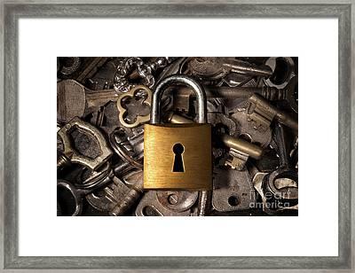 Padlock Over Keys Framed Print by Carlos Caetano