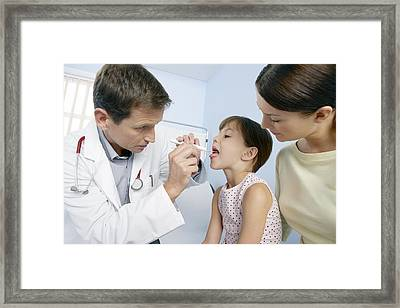 Paediatric Examination Framed Print by Adam Gault
