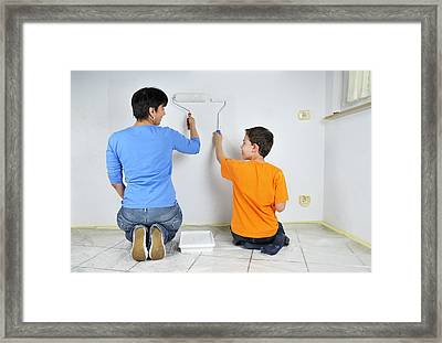 Paintwork - Mother And Son Painting Wall Together Framed Print by Matthias Hauser