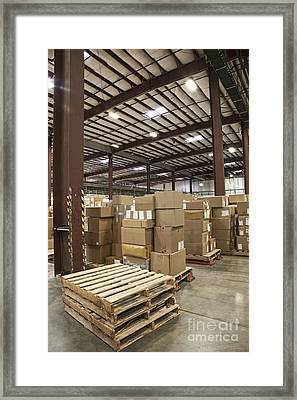 Pallets And Boxes In A Warehouse Framed Print by Jetta Productions, Inc