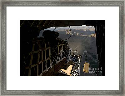 Pallets Are Released From A C-17 Framed Print by Stocktrek Images