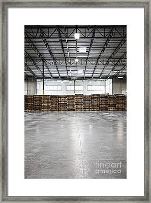 Pallets In An Empty Warehouse Framed Print by Jetta Productions, Inc