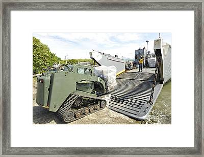 Pallets Of Donated Goods Are Removed Framed Print by Stocktrek Images