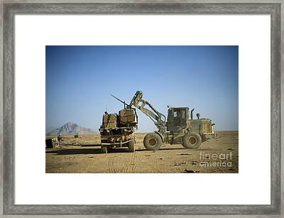 Pallets Of Food Rations Are Loaded Onto Framed Print by Stocktrek Images