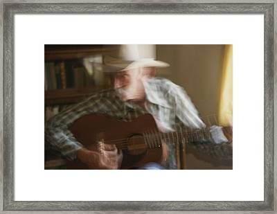 Panned View Of A Cowboy  Playing Framed Print by Stacy Gold