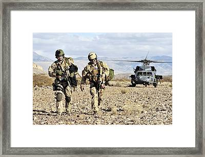 Pararescuemen Depart From A Hh-60g Pave Framed Print by Stocktrek Images