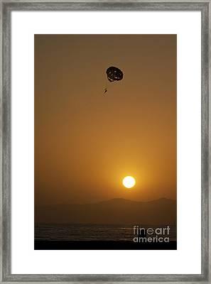 Parasailing At Sunset Framed Print by Micah May