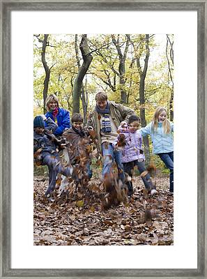 Parents And Children Playing In A Wood Framed Print