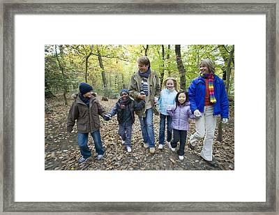 Parents And Children Walking In A Wood Framed Print