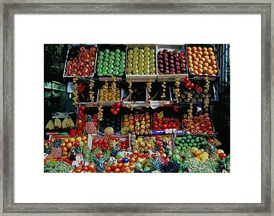 Framed Print featuring the photograph Paris Market Display With A Glow by Tom Wurl