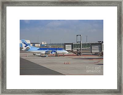 Parked Airplane At An Airport Gate Framed Print by Jaak Nilson