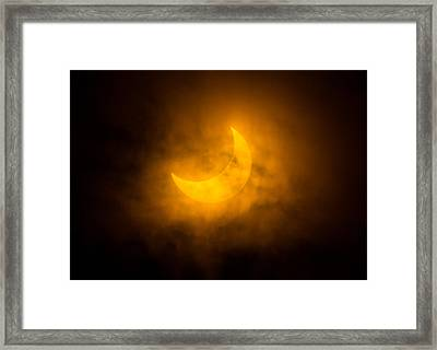 Partial Solar Eclipse Through Fog Framed Print by Greg Nyquist