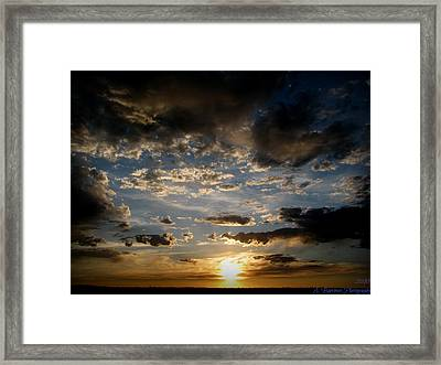 Partly Cloudy Skies At Sunset Framed Print by Aaron Burrows