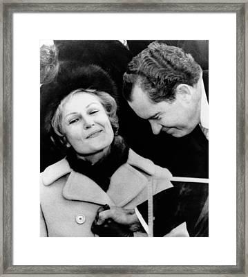 Pat Nixon Grasps Her Husbands Hand Framed Print by Everett