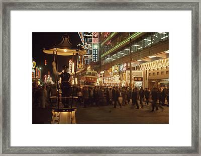 Pedestrians Swarm Through Kowloons Framed Print by John Scofield