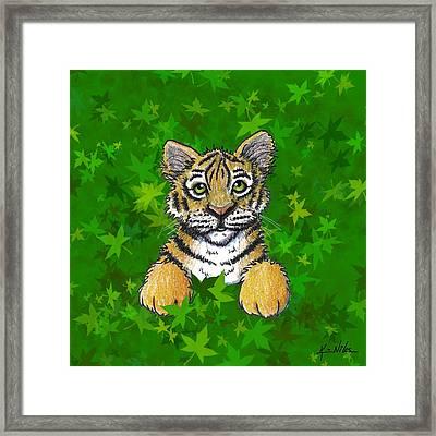 Peeking Tiger Framed Print by Kim Niles