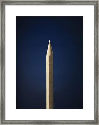 Pencil Against A Blue Background Framed Print by Stuart Minzey