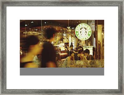 People At One Of The First Starbucks Framed Print