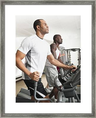 People Exercising In Health Club Framed Print by Erik Isakson