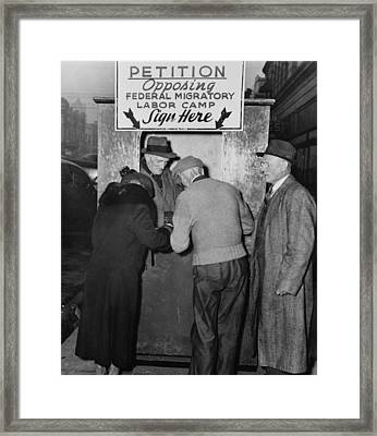 People Sign A Petition Opposing Framed Print