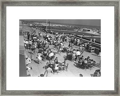 People Sitting At Tables By Beach, (b&w), Elevated View Framed Print by George Marks