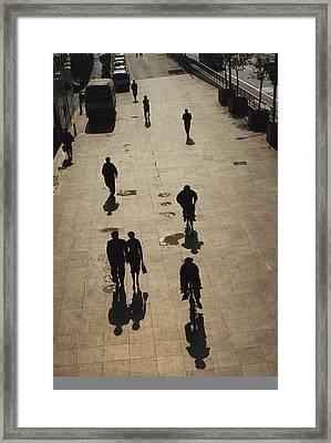 People Walk Along The Bund Wai Tan Framed Print by Justin Guariglia