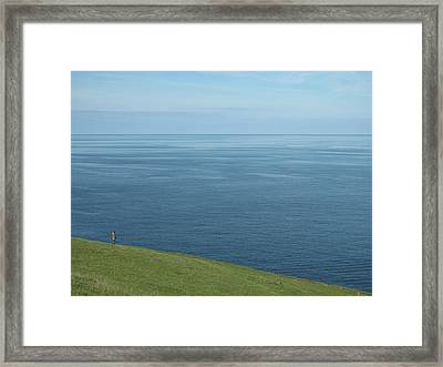 Person Looking Out To Sea In Cornwall Framed Print by Thepurpledoor
