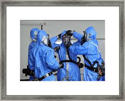 Personnel Dressed In Hazmat Suits Framed Print by Stocktrek Images