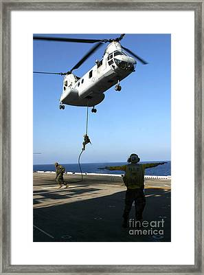 Personnel Fast-rope From The Rear Framed Print by Stocktrek Images