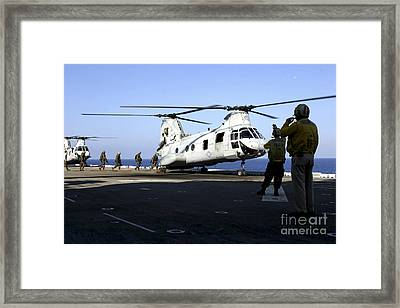 Personnel Walk Into The Rear Framed Print by Stocktrek Images