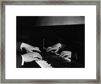 Pianist's Hands Framed Print by Sasha