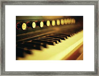 Piano Keys And Buttons Framed Print by photographer, loves art, lives in Kyoto