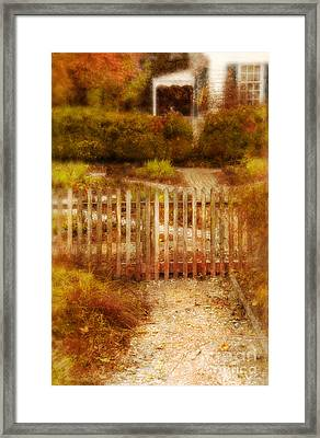 Picket Fence And Cottage Framed Print