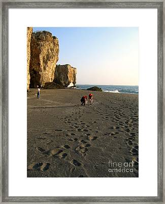 Picking Shells On The Beach Framed Print by Yali Shi
