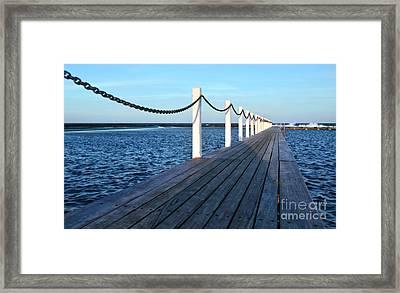 Pier To The Ocean Framed Print by Kaye Menner