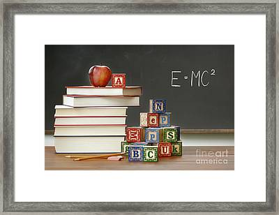 Pile Of Books With Wooden Blocks Framed Print by Sandra Cunningham